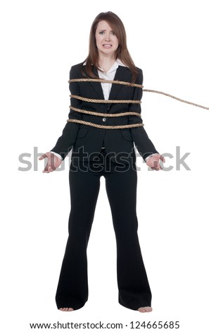 Portrait of a worried businesswoman with a tied rope around her body - stock photo