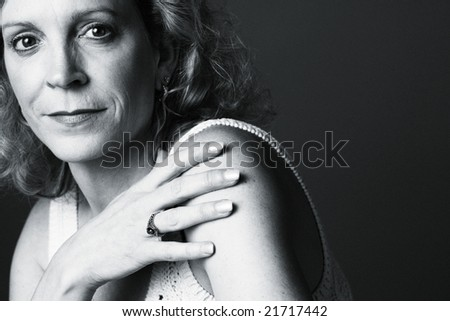 Portrait of a 50 year old woman on a plain background