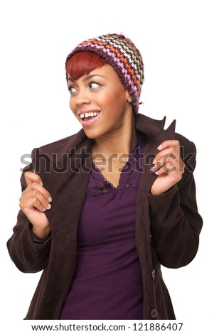 Portrait of a young African American woman holding her jacket and looking to the side. Isolated on white background