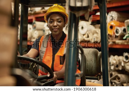 Portrait of a young African female forklift operator moving boxes around a textile warehouse Stock foto ©