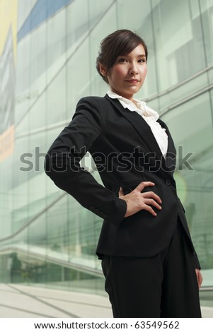 Portrait of a young asian confidential businesswoman standing alone - stock photo