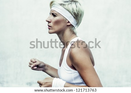 portrait of a young athletic girl running