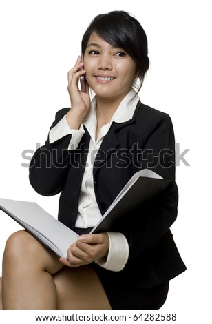 Portrait of a young attractive Asian business woman talking on the telephone