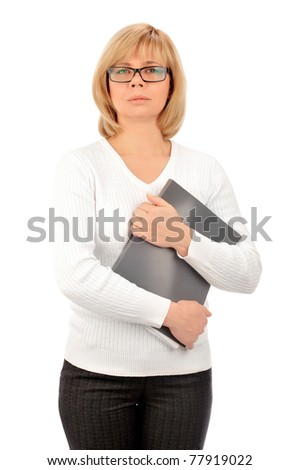 Portrait of a young attractive business woman holding folder with files in her arms and looking at camera. Isolated on white background