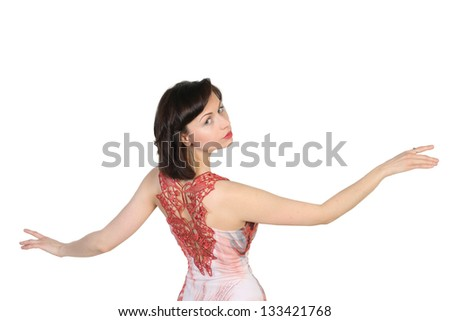 Portrait of a young  attractive girl with raised open hands on white background. Place for text design.
