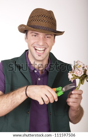 Portrait of a young attractive male gardener smiling.
