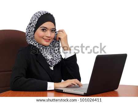 Portrait of a young attractive muslim business woman with laptop