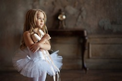 Portrait of a young ballerina. Image with selective focus, noise effects and toning. Focus on the girl.