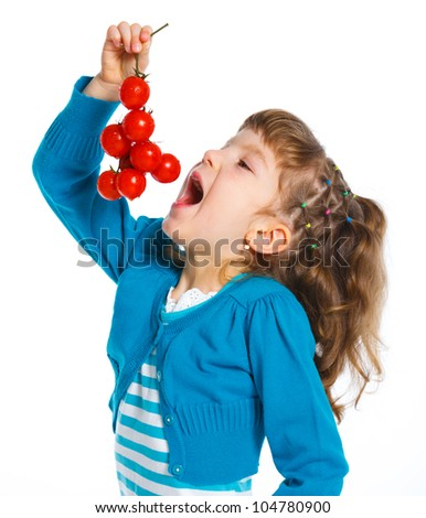 Portrait of a young beautiful brunette girl eating cherry tomatoes, isolated against white background - stock photo