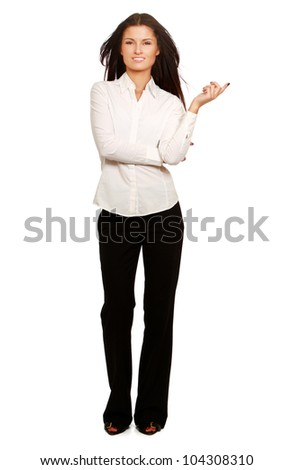 Portrait of a young beautiful businesswoman pointing something, isolated on white background