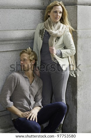 Portrait of a young beautiful couple. Guy and girl are looking at different directions.