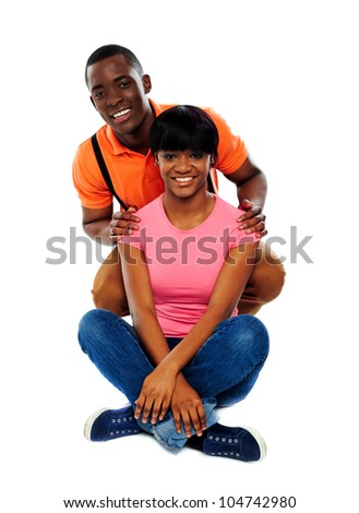 Portrait of a young beautiful couple in studio isolated on white
