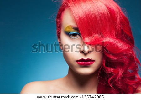 portrait of a young beautiful female model with colorful hair and makeup