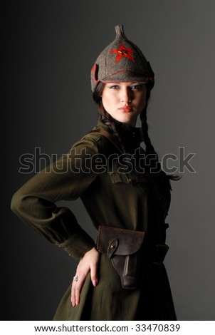... beautiful girl in the uniform of the red army on dark gray background