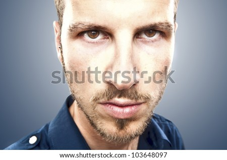 portrait of a young beautiful man, serious face expression