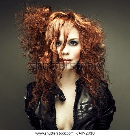 Stock Photo Portrait of a young beautiful redheaded girl