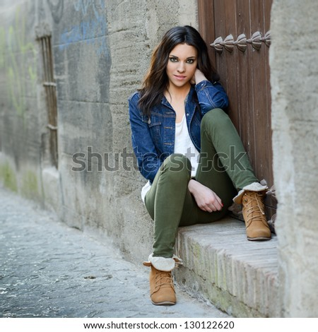 Portrait of a young beautiful woman in a urban background