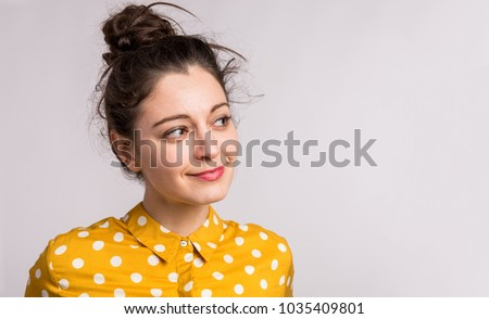 Portrait of a young beautiful woman in studio.