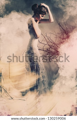 Portrait of a young beautiful woman in the wedding with the smoke
