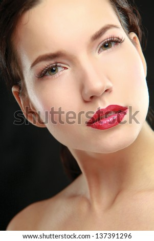 Portrait of a young beautiful woman, isolated on black background