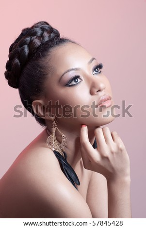 Portrait of a young beautiful woman, isolated on pink