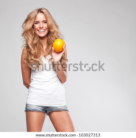 Portrait of a young beautiful woman with orange stock photo