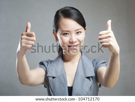 portrait of a young beautiful woman with two thumbs up