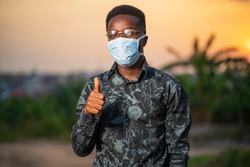 Portrait of a young black man wearing surgical face mask for protection after covid-19 lock down or quarantine - African millennial lifestyle and corona virus pandemic
