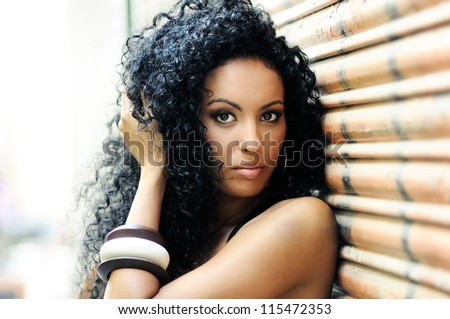 Stock Photo Portrait of a young black woman, model of fashion in urban background
