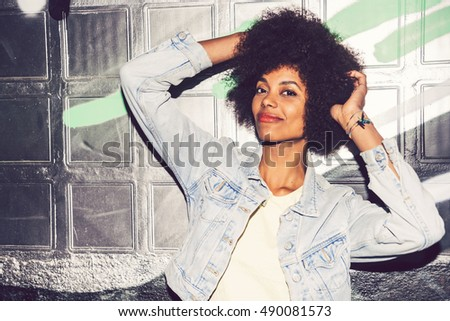 Portrait of a young black woman, model of fashion in urban background #490081573