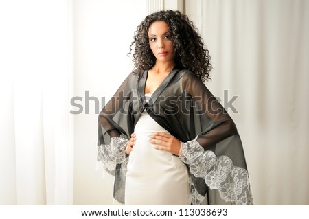 Portrait of a young black woman, model of fashion, with party dress