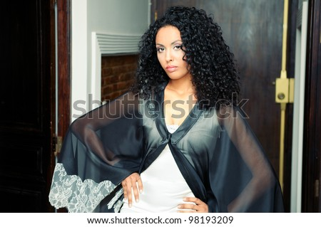 Portrait of a young black woman, model of fashion, with party dress - stock photo