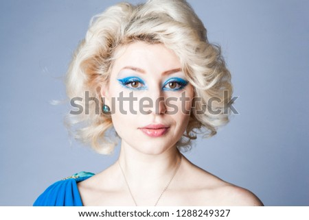 Beautiful Blonde Girl With Blue Eyes And Light Blue Dress Images And