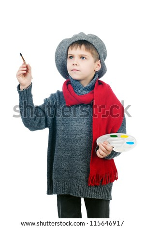 Portrait of a young boy dressed up in a vintage painter, isolated on white background