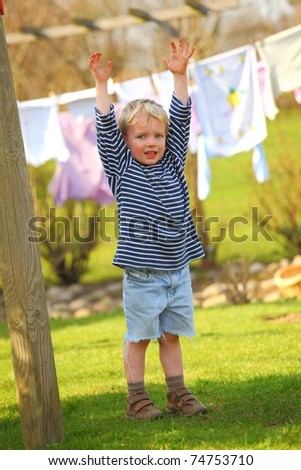 Portrait of a young boy outside in the garden