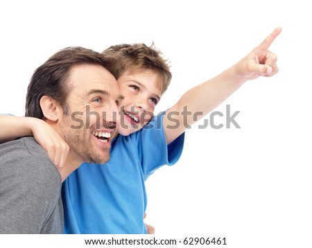 Portrait of a young boy showing some thing intersting to his father against white background