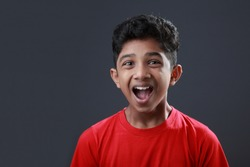 Portrait of a young boy with an excited face