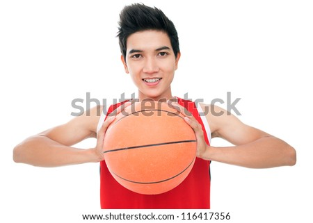 Portrait of a young boy with basketball looking at camera and smiling