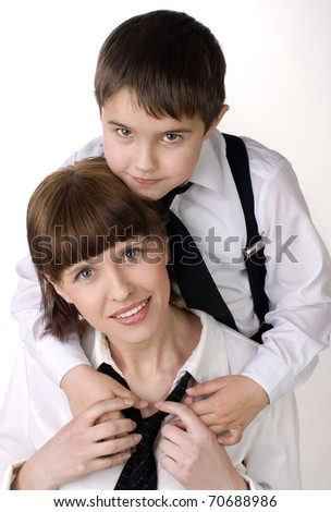 Portrait of a  young boy with his mother against white background