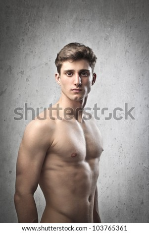 Portrait of a young brawny bare-chested young man