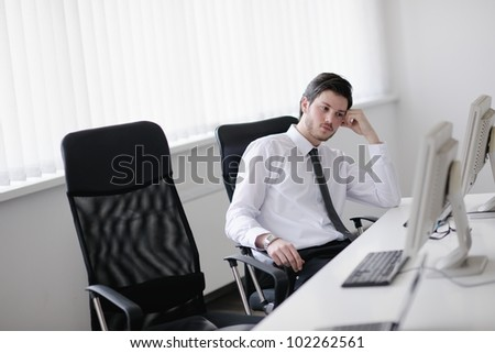 Portrait of a young business man looking depressed and worried from work at meeting office indors - stock photo