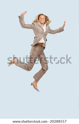 stock photo : Portrait of a young business woman jumping against isolated background