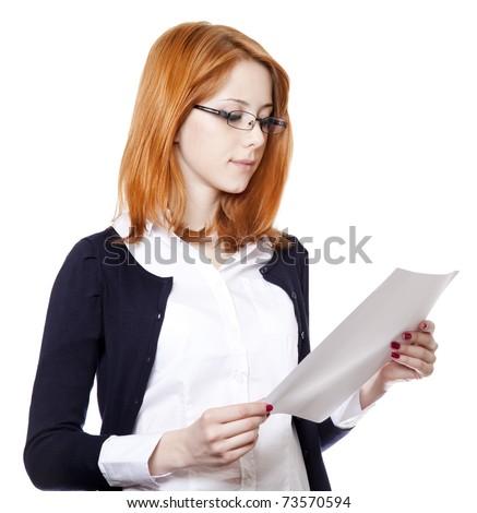 Portrait of a young business woman reading paper. Studio shot.