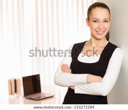 Portrait of a young business woman standing in office