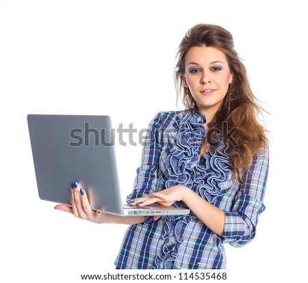 Portrait of a young business woman standing with notebook against white background