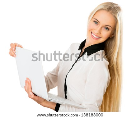 Portrait of a young business woman using laptop - stock photo