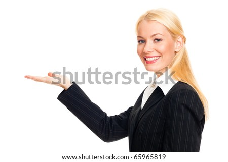 Portrait of a young business woman. with her hand outstretched, as though she is presenting something