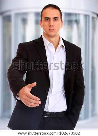 Portrait of a  young businessman at corporate entrance