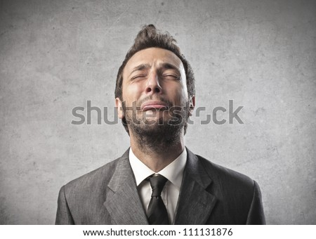 Portrait of a young businessman crying