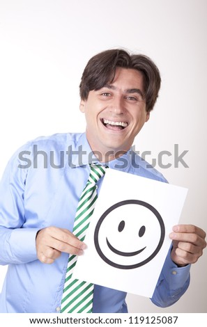 Portrait of a young businessman holding a smiley sign.